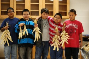 White Earth Land Recovery Project: Pine Point students with manitoba flint corn