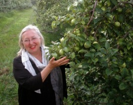 Elizabeth Ryan proudly displays the apples growing at the Stone Ridge Orchard.